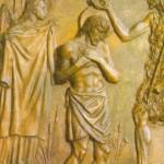 """Drugi rząd brązowych płyt - kwatera piąta - rozpoczyna scena chrztu Jezusa w Jordanie. Jezus stoi w przejrzystej wodzie. Ma lekko pochyloną głowę i dłonie złożone na piersi. W wielkim skupieniu przyjmuje chrzest z rąk Jana Chrzciciela, ukazanego tu z profilu, odzianego w charakterystyczną owczą skórę. Nad Jezusem unosi się gołąb - symbol obecności Ducha  Świętego. Po lewej stronie stoi anioł. Patrzy na Jezusa, a w rękach trzyma czystą szatę dla Niego. Nad głowami tych trzech postaci biegnie napis: TU venis ad me? """"TY przychodzisz do mnie?""""  Są to słowa zdumionego św. Jana Chrzciciela skierowane do Jezusa, a przytoczone w Ewangelii św. Mateusza (3, 14)."""